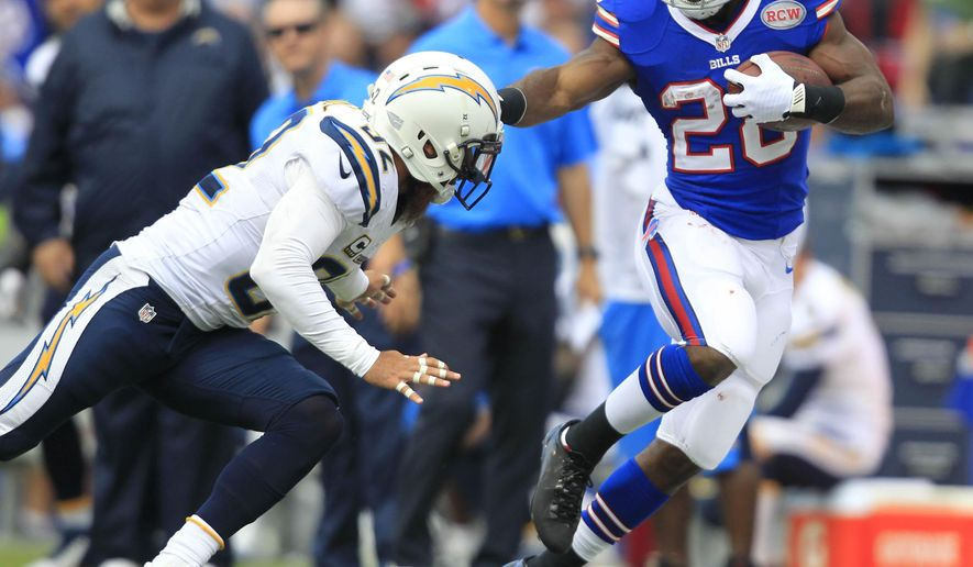 Buffalo Bills running back C.J. Spiller (28) makes some room to run against San Diego Chargers' Eric Weddle during the second quarter of an NFL football game Sunday, Sept. 21, 2014, in Orchard Park, N.Y. The Chargers won 22-10. (AP Photo/The Buffalo News, Harry Scull Jr.)