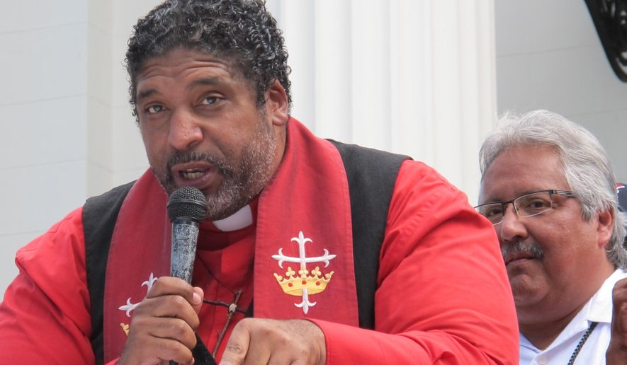 The Rev. William Barber II, founder of the Forward Together Moral Movement in North Carolina, addresses a rally, Monday, Sept. 22, 2014, on the state Capitol steps in Montgomery, Ala. The rally was organized by Alabama groups seeking to start a similar movement in Alabama.(AP Photo/Phillip Rawls)
