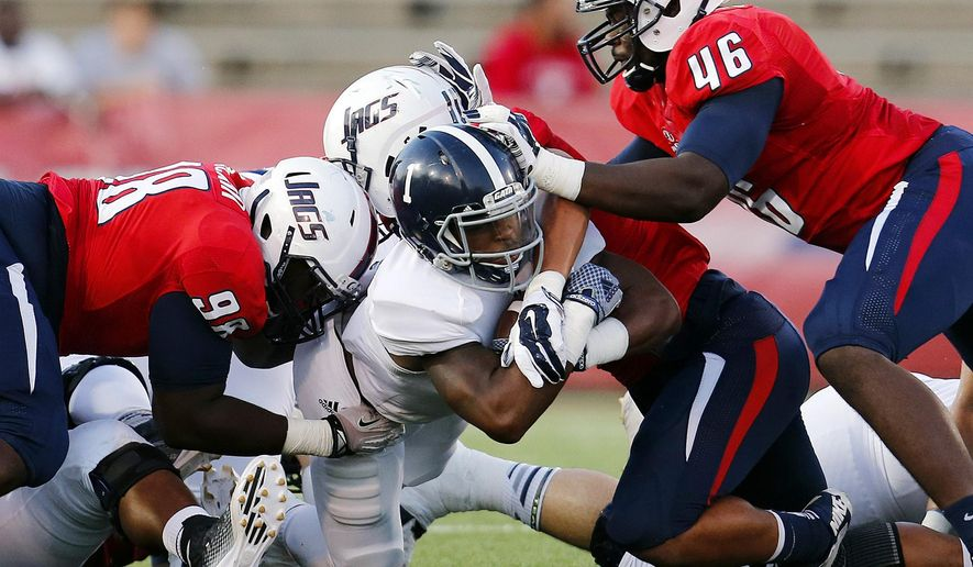 South Alabama defensive lineman Jerome McClain (98), linebacker Davin Hawkins (11) and defensive end Ridge James (46) stop Georgia Southern running back Alfred Ramsby (1) in the first half of an NCAA college football game Saturday, Sept. 20, 2014, at Ladd-Peebles Stadium in Mobile, Ala. (AP Photo/AL.com, Mike Kittrell)