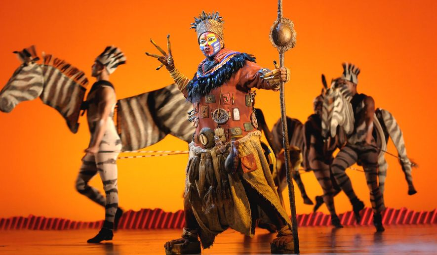 """FILE - In this photo provided by the Las Vegas News Bureau, a scene is shown during a performance of Disney's """"The Lion King,"""" in Las Vegas. With a worldwide gross of over $6.2 billion, """"The Lion King"""" stage musical has now achieved the most successful box office total of any work in any media in entertainment history. (AP Photo/Las Vegas News Bureau, Darrin Bush, FIle)"""