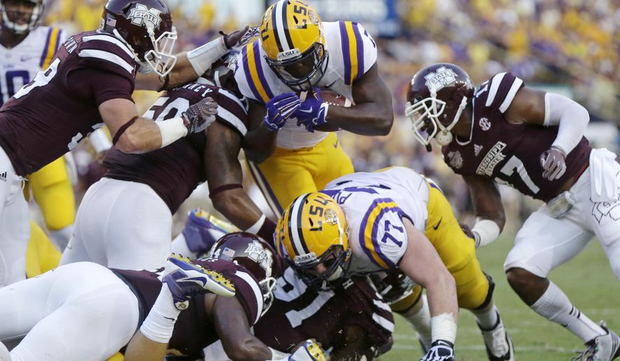 LSU running back Leonard Fournette (7) is stopped near the goal line in the first half of an NCAA college football game against Mississippi State in Baton Rouge, La., Saturday, Sept. 20, 2014. (AP Photo/Gerald Herbert)