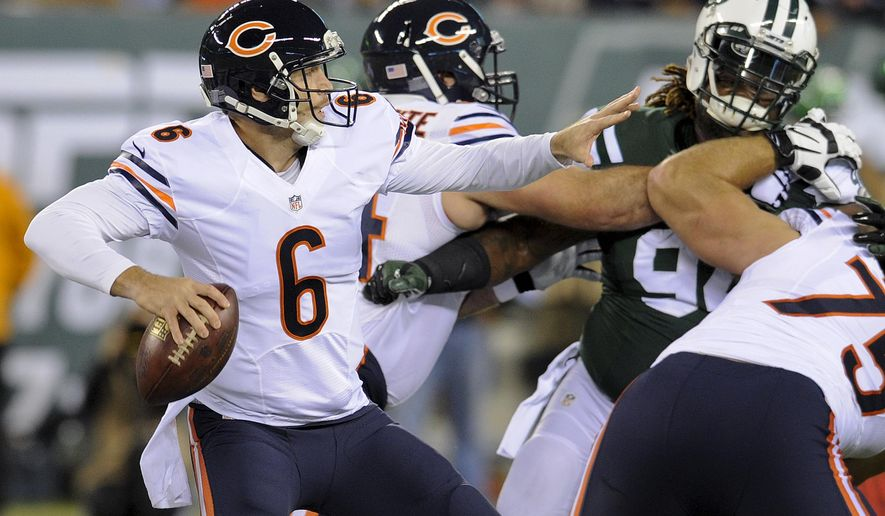 Chicago Bears quarterback Jay Cutler (6) throws under pressure from the New York Jets in the first quarter of an NFL football game, Monday, Sept. 22, 2014, in East Rutherford, N.J. (AP Photo/Bill Kostroun)