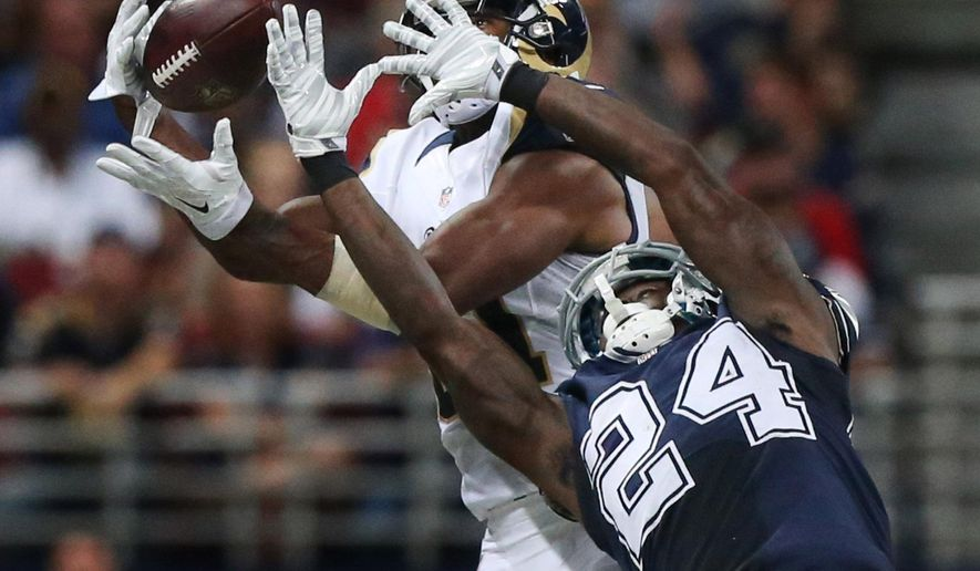 St. Louis Rams wide receiver Kenny Britt, top, catches a 38-yard pass while being defended by Dallas Cowboys cornerback Morris Claiborne in the third quarter of an NFL football game on Sunday, Sept. 21, 2014, in St. Louis. (AP Photo/St. Louis Post-Dispatch, Chris Lee)   EDWARDSVILLE INTELLIGENCER OUT; THE ALTON TELEGRAPH OUT