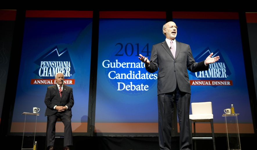 Democrat Tom Wolf, right, speaks during a gubernatorial debate with Republican Gov. Tom Corbett on Monday, Sept. 22, 2014, in Hershey, Pa. The debate is hosted by the Pennsylvania Chamber of Business and Industry. (AP Photo/Matt Rourke)