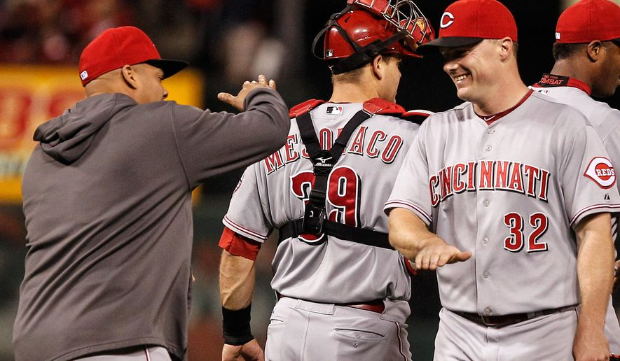 Cincinnati Reds' Jay Bruce, right, and teammates celebrate their 7-2 victory over the St. Louis Cardinals in a baseball game Sunday, Sept. 21, 2014, in St. Louis. (AP Photo/Sarah Conard)