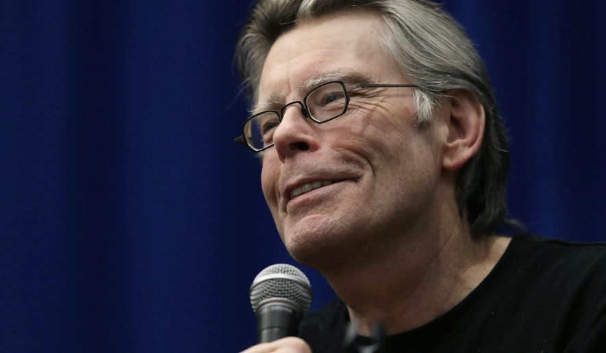 "FILE - In this Dec. 7, 2012 file photo, novelist Stephen King speaks to creative writing students at the University of Massachusetts-Lowell in Lowell, Mass. King's time-travel novel about the Kennedy assassination is being adapted as a small-screen miniseries. Streaming service Hulu said Monday, Sept. 22, 2014, that the nine-hour series, titled ""11/22/63"" after King's book, includes the author and J.J. Abrams as executive producers. (AP Photo/Elise Amendola, file)"