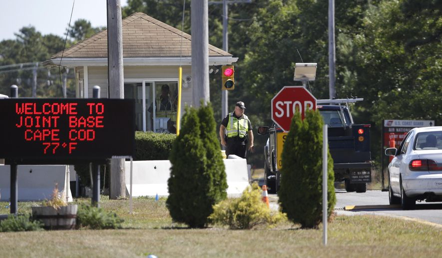 Vehicles are stopped by security personal as they enter a gate Monday, Sept. 22, 2014, to Camp Edwards, Mass., on Cape Cod. Police and military officials were searching Monday for three soldiers from the Afghanistan National Army who went missing Saturday during a training exercise at the base. The Afghan soldiers had been participating in a U.S. Central Command Regional Cooperation training exercise at Joint Base Cape Cod, at Camp Edwards, U.S. military officials said. (AP Photo/Steven Senne)