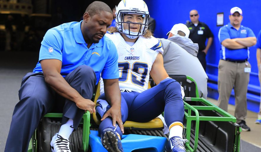 San Diego Chargers running back Danny Woodhead leaves the game with an ankle injury in the first quarter against the Buffalo Bills in an NFL football game Sunday, Sept. 21, 2014, in Orchard Park, N.Y. The Chargers won 22-10. (AP Photo/The Buffalo News, Harry Scull Jr.)