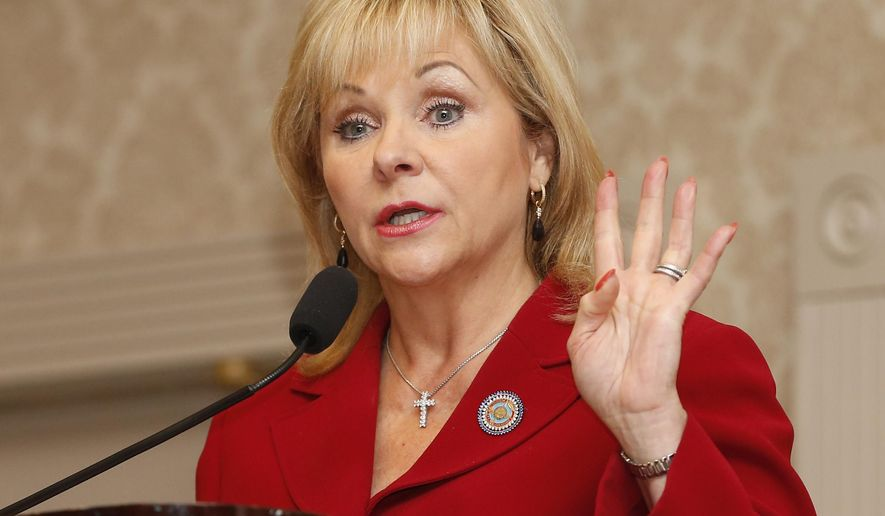 Oklahoma Governor Mary Fallin speaks in Oklahoma City, Monday, Sept. 22, 2014. Launching an uphill battle against an entrenched incumbent in the race for Oklahoma governor, a little-known Democratic state representative from Rush Springs is throwing the first punch with an ad attacking Fallin for her initial support of the common core education standards. (AP Photo/Sue Ogrocki)