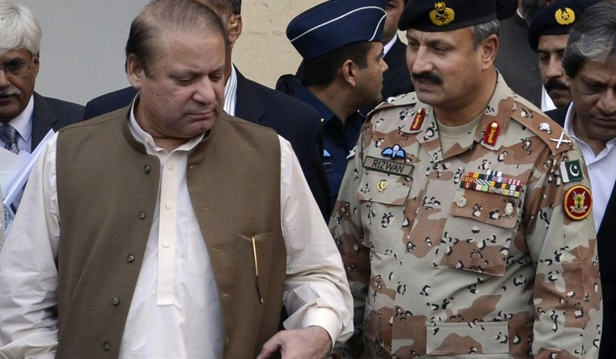In this undated handout photo released by Pakistan's rangers, Maj. Gen. Rizwan Akhtar, right, walks with Prime minister Nawaz Sharif in Karachi, Pakistan. Pakistan's army on Monday, Sept. 22, 2014, named a new chief to head the country's premier intelligence agency, the Inter-Services Intelligence Directorate, which is also known by its acronym ISI. (AP Photo/Pakistan Rangers)