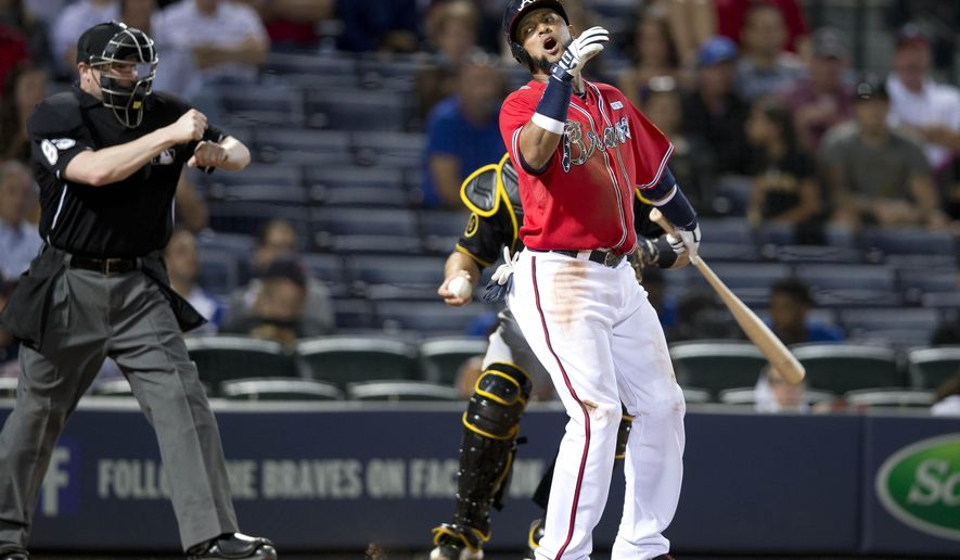 Atlanta Braves' Emilo Bonifacio reacts after striking out in the 8th inning of a baseball game against the Pittsburgh Pirates Monday, Sept. 22, 2014, in Atlanta. Pittsburgh won 1-0. (AP Photo/John Bazemore)