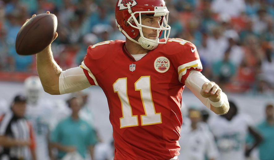 Kansas City Chiefs quarterback Alex Smith looks to pass during the second half of an NFL football game against the Miami Dolphins, Sunday, Sept. 21, 2014, in Miami Gardens, Fla. The Chiefs defeated the Dolphins 34-15. (AP Photo/Lynne Sladky)