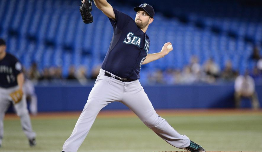 Seattle Mariners pitcher James Paxton throws against the Toronto Blue Jays during first inning American League action in Toronto on Monday Sept. 22, 2013. (AP Photo/The Canadian Press, Frank Gunn)