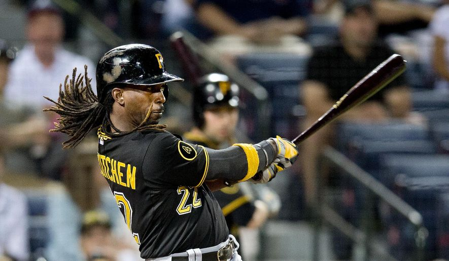 Pittsburgh Pirates' Andrew McCutchen (22) follows through on a solo-home run in the sixth inning of a baseball game against the Atlanta Braves Monday, Sept. 22, 2014, in Atlanta. (AP Photo/John Bazemore)