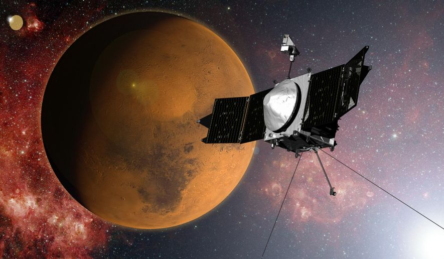 In this artist concept provided by NASA, the MAVEN spacecraft approaches Mars on a mission to study its upper atmosphere. Late Sunday night, Sept. 21, 2014,NASA's Maven spacecraft entered orbit around Mars for an unprecedented study of the red planet's atmosphere following a 442 million-mile journey that began nearly a year ago. (AP Photo/NASA)