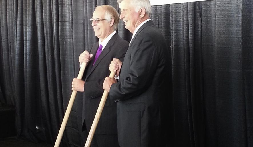 John Correnti, left, and Arkansas Gov. Mike Beebe pose at groundbreaking ceremonies for Big River Steel in Osceola, Ark., Monday, Sept. 22, 2014. (AP Photo/Shannon Spears Harris)