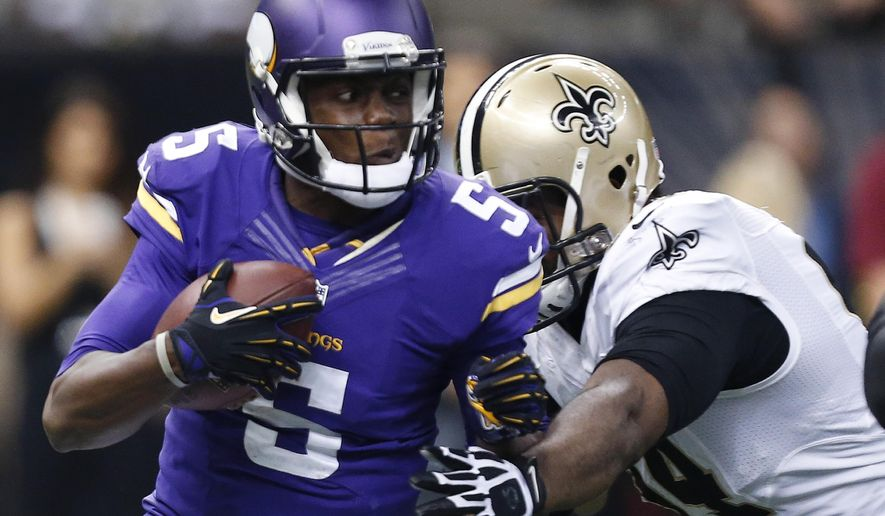 Minnesota Vikings quarterback Teddy Bridgewater (5) is sacked by New Orleans Saints defensive end Cameron Jordan in the second half of an NFL football game in New Orleans, Sunday, Sept. 21, 2014. (AP Photo/Rogelio Solis)