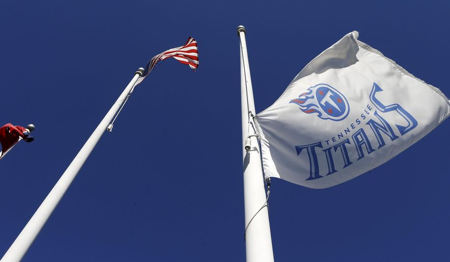 The Tennessee Titan flag flies at half staff at the team headquarters in honor of former kicker Rob Bironas on Monday, Sept. 22, 2014, in Nashville, Tenn. Bironas died Saturday night, Sept. 20, after a car accident near his Nashville home, according to police. (AP Photo/Mark Humphrey)