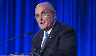 In this May 12, 2014, file photo, former New York City Mayor Rudy Giuliani speaks at the Manhattan Institute for Policy Research Alexander Hamilton Award Dinner in New York. (AP Photo/John Minchillo, File)