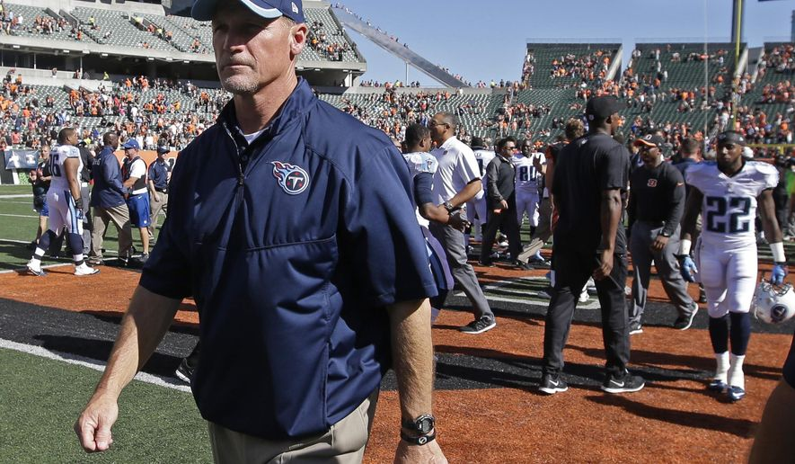 Tennessee Titans head coach Ken Whisenhunt walks off the field after the Cincinnati Bengals defeated the Titans 33-7 in an NFL football game, Sunday, Sept. 21, 2014, in Cincinnati. (AP Photo/Darron Cummings)