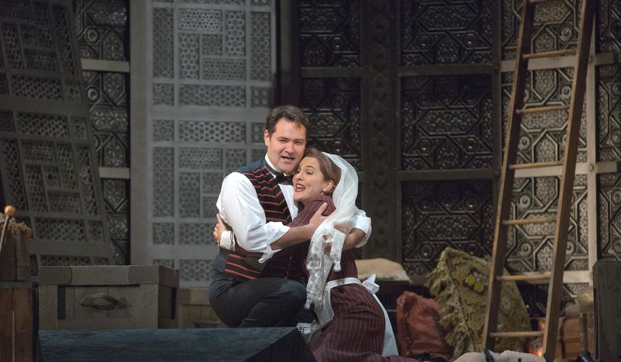 """In this image released by the Metropolitan Opera, Ildar Abdrazakov as Figaro, left, and Marlis Petersen as Susanna perform in Mozart's """"Le Nozze di Figaro,"""" during a rehearsal in New York. Richard Eyre's new production of the opera, conducted by James Levine, opens the Met season on Sept. 22, 2014. (AP Photo/Metropolitan Opera, Ken Howard)"""
