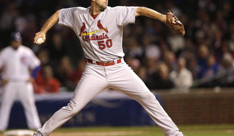 St. Louis Cardinals starting pitcher Adam Wainwright delivers during the first inning of a baseball game against the Chicago Cubs Monday, Sept. 22, 2014, in Chicago. (AP Photo/Charles Rex Arbogast)