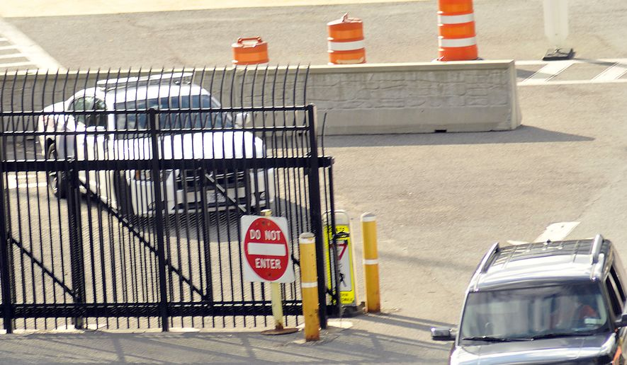 In this file photo, a United States Border Patrol car sits next to the entrance to the United States from Canada on the Rainbow Bridge that connects Niagara Falls, New York and Niagara Falls, Ontario, Canada, Monday, Sept. 22, 2014. (AP Photo/The Niagara Gazette, Dan Cappellazzo) **FILE**