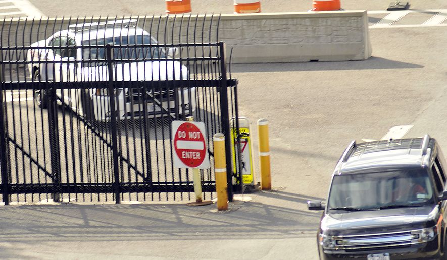A United States Border Patrol car sits next to the entrance to the United States from Canada on the Rainbow Bridge that connects Niagara Falls, New York and Niagara Falls, Ontario, Canada, Monday, Sept. 22, 2014. Three Afghanistan National Army officers who went missing during a training exercise at a Cape Cod military base were detained Monday at the U.S.-Canadian border, Massachusetts law enforcement officials said.  (AP Photo/The Niagara Gazette, Dan Cappellazzo)