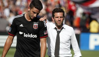 D.C. United head coach Ben Olsen, right, walks off the field with defender Steve Birnbaum (15) after an MLS soccer match against the New York Red Bulls, at RFK Stadium, Sunday, Aug. 31, 2014, in Washington. United won 2-0. (AP Photo/Alex Brandon)