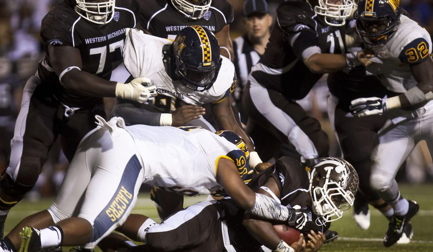 Western Michigan running back Jarvion Franklin is taken down by the Murray State defense during an NCAA college football game Saturday, Sept. 20, 2014, in Kalamazoo, Mich. (AP Photo/The Gazette, Katie Alaimo)