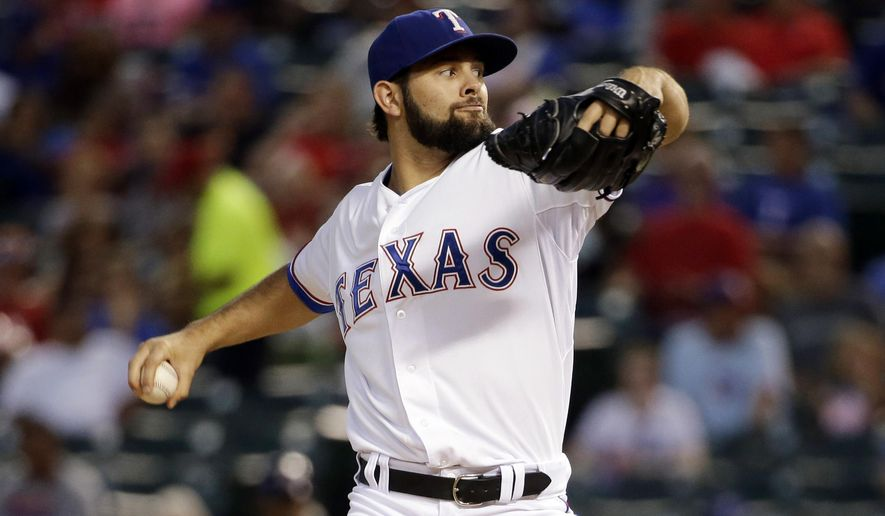 Texas Rangers starting pitcher Nick Martinez works against the Houston Astros in the second inning of a baseball game, Tuesday, Sept. 23, 2014, in Arlington, Texas. (AP Photo/Tony Gutierrez)