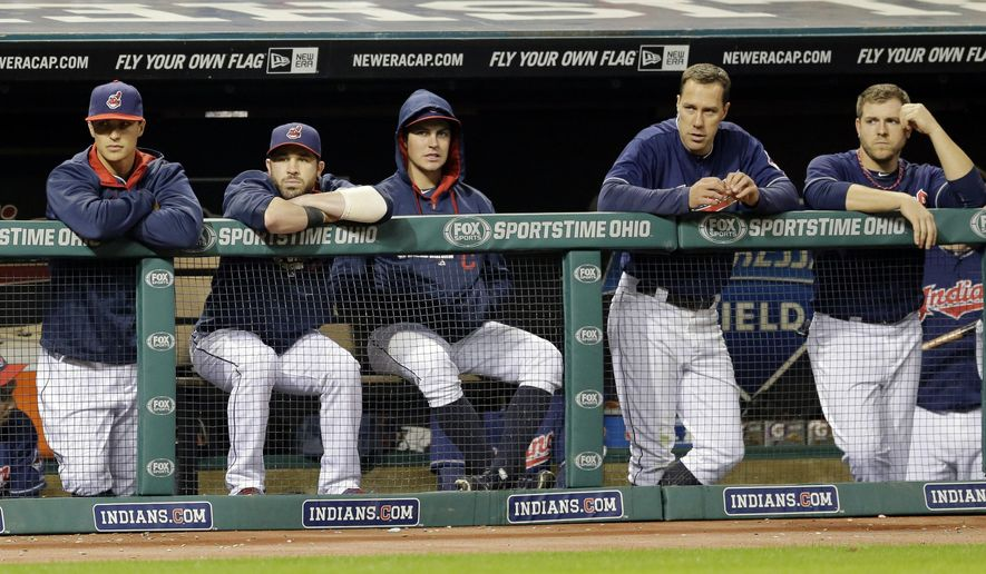 Members of the Cleveland Indians watch from the dugout in the ninth inning of a baseball game against the Kansas City Royals, Tuesday, Sept. 23, 2014, in Cleveland. The Royals won 7-1. (AP Photo/Tony Dejak)