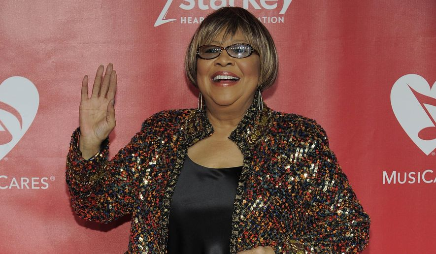 "FILE - In this Feb. 8, 2013, file photo, Mavis Staples arrives at the MusiCares Person of the Year tribute honoring Bruce Springsteen at the Los Angeles Convention Center in Los Angeles. An all-star lineup of musicians including Gregg Allman, Aaron Neville, Taj Mahal, Eric Church, Michael McDonald, Patty Griffin and more will salute Staples during the ""I'll Take You There - Celebrating 75 Years of Mavis Staples"" event on Nov. 19, 2014, in Chicago. (Photo by Chris Pizzello/Invision/AP, File)"