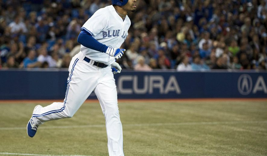 Toronto Blue Jays' Dalton Pompey rounds the bases after hitting a solo home run against the Seattle Mariners during the fifth inning of a baseball game in Toronto on Tuesday, Sept. 23, 2014. (AP Photo/The Canadian Press, Nathan Denette)