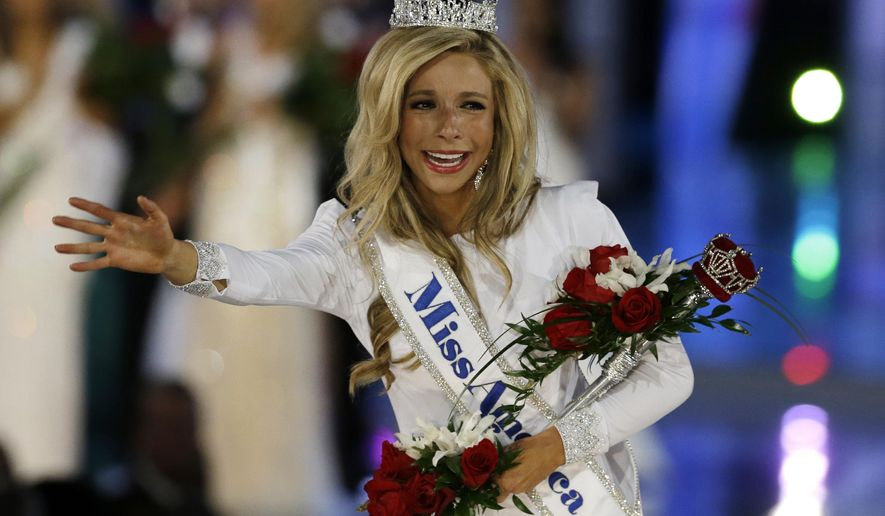 "FILE - In this Sept. 14, 2014 file photo, Kira Kazantsev walks the runway after she was named Miss America 2015 in Atlantic City, N.J. Kazantsev said Tuesday, Sept. 23, 2014 that she was removed from her college sorority over a letter that made light of hazing, but she denies a report that she was involved in aggressively hazing fellow students. She said on ABC's ""Good Morning America"" that she was asked to leave the Alpha Phi sorority at Hofstra University after sending an email to alumni that included what she said was a joke about making an event ""scary"" for pledges. (AP Photo/Mel Evans, File)"