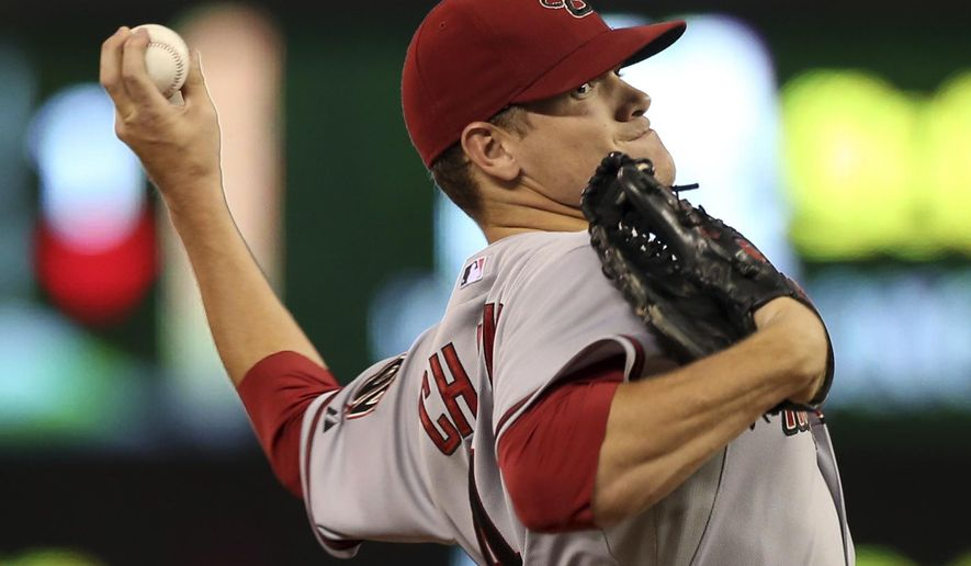 Arizona Diamondbacks pitcher Andrew Chafin throws against the Minnesota Twins in the first inning of a baseball game, Tuesday, Sept. 23, 2014, in Minneapolis. (AP Photo/Jim Mone)