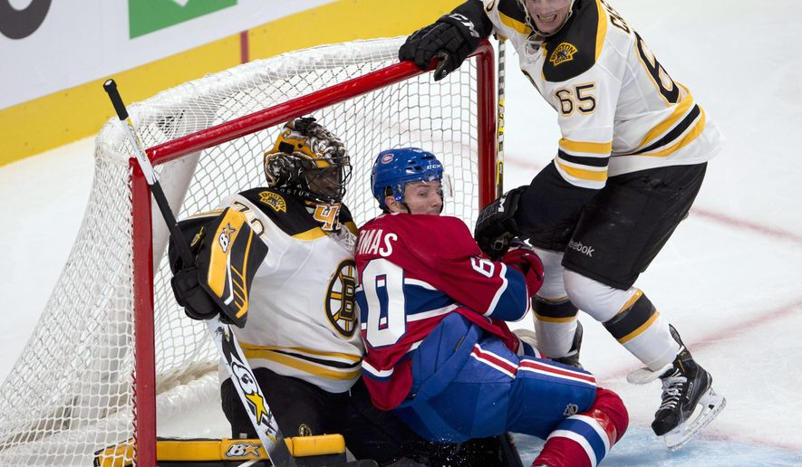 Montreal Canadiens right wing Christian Thomas (60) is checked into Boston Bruins goalie Malcolm Subban (70) by Boston Bruins defenseman Chris Casto (65) during the third period of an NHL pre-season hockey game, Tuesday, Sept. 23, 2014 in Montreal. (AP Photo/The Canadian Press, Ryan Remiorz)
