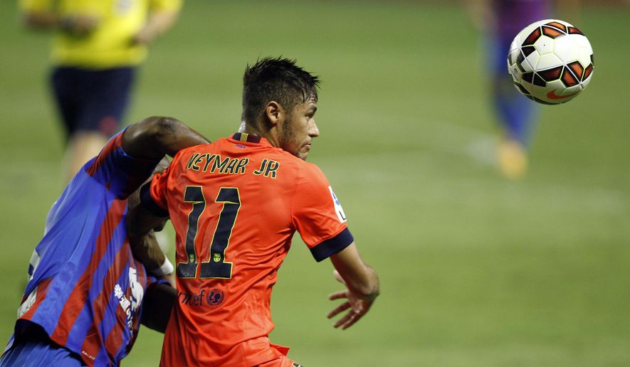 Barcelona's Neymar, right, from Brazil, vies for the ball between Levante's Simao, from Mozambique, Spanish La Liga soccer match at the Ciutat de Valencia stadium in Valencia, Spain, on Sunday, Sept. 21, 2014.(AP Photo/Alberto Saiz)