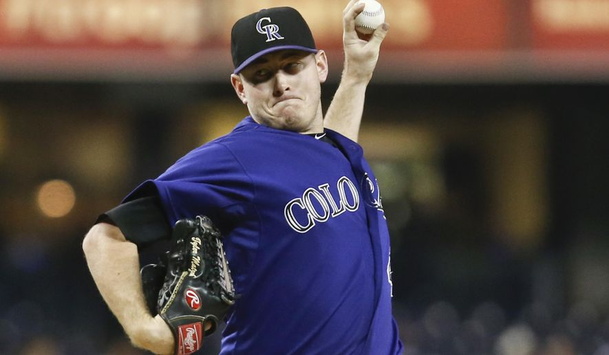 Colorado Rockies starting pitcher Tyler Matzek works against the San Diego Padres during the first inning of a baseball game Monday, Sept. 22, 2014, in San Diego.  (AP Photo/Lenny Ignelzi)