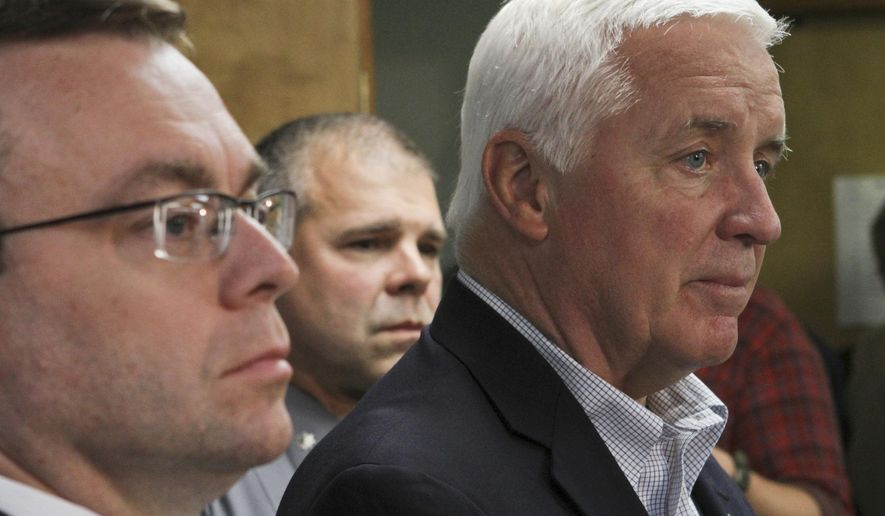 Pennsylvania Gov. Tom Corbett speaks of accused cop killer Eric Matthew Frein during a news conference at Blooming Grove Municipal Township Building in Blooming Grove Township, Pa., Monday, Sept. 22, 2014. At left is Pike County District Attorney Ray Tonkin and in center is Pennsylvania State Police Lt. Col. George Bivens. (AP Photo/Scranton Times-Tribune, Michael J. Mullen)
