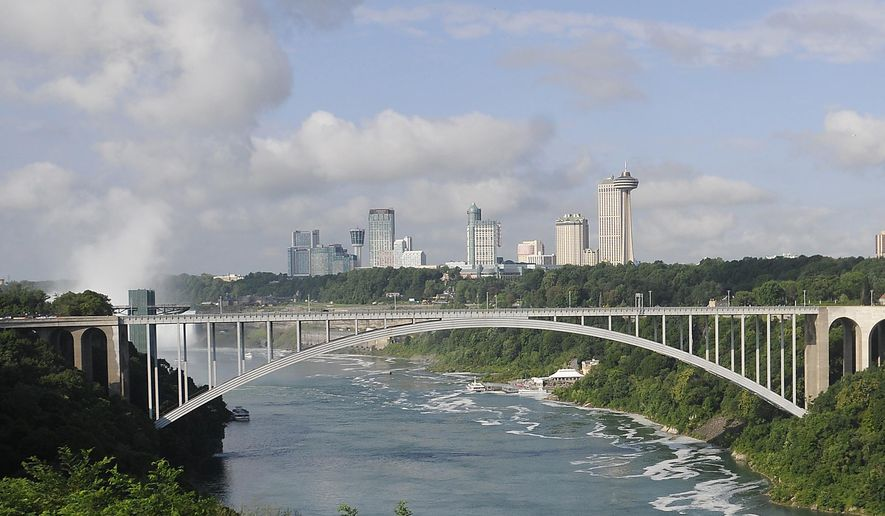 This Aug. 7, 2014 photo, shows the Rainbow Bridge which connects Niagara Falls, New York and Niagara Falls, Ontario, Canada. Three Afghanistan National Army officers who went missing during a training exercise at a Cape Cod military base were detained Monday, Sept. 22, 2014, at the U.S.-Canadian border, Massachusetts law enforcement officials said.  (AP Photo/The Niagara Gazette,Dan Cappellazzo)  BUFFALO NEWS OUT; BATAVIA DAILY NEWS OUT