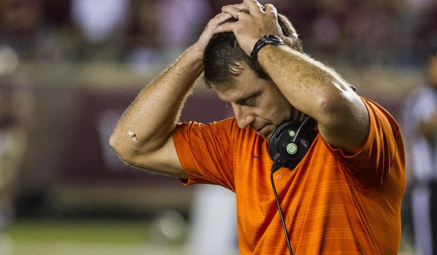 Clemson coach Dabo Swinney reacts at the end of regulation against Florida State in an NCAA college football game in Tallahassee, Fla., Saturday, Sept. 20, 2014. Florida State defeated Clemson 23-17 in overtime. (AP Photo/Mark Wallheiser)