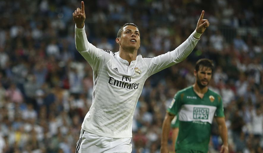 Real's Cristiano Ronaldo celebrates his third goal during a Spanish La Liga soccer match between Real Madrid and Elche at the Santiago Bernabeu stadium in Madrid, Spain, Tuesday, Sept. 23, 2014. (AP Photo/Andres Kudacki)
