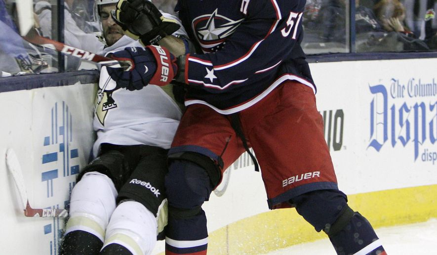 Columbus Blue Jackets' Fedor Tyutin, right, of Russia, checks Pittsburgh Penguins' Dominik Uher, of the Czech Republic, during the third period of an NHL preseason hockey game Tuesday, Sept. 23, 2014, in Columbus, Ohio. The Blue Jackets beat the Penguins 2-0. (AP Photo/Jay LaPrete)