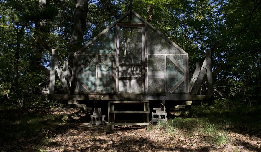 This Monday, Sept. 22, 2014 photo shows an old cabin filled with leaves at Girl Scout Camp O'Fairwinds in Lapeer, Mich. An auction will sell items of possible value from the shuttered camp as officials work to determine what will happen to the land where it operated for decades. (AP Photo/The Flint Journal, Erin Kirkland) LOCAL TELEVISION OUT; LOCAL INTERNET OUT