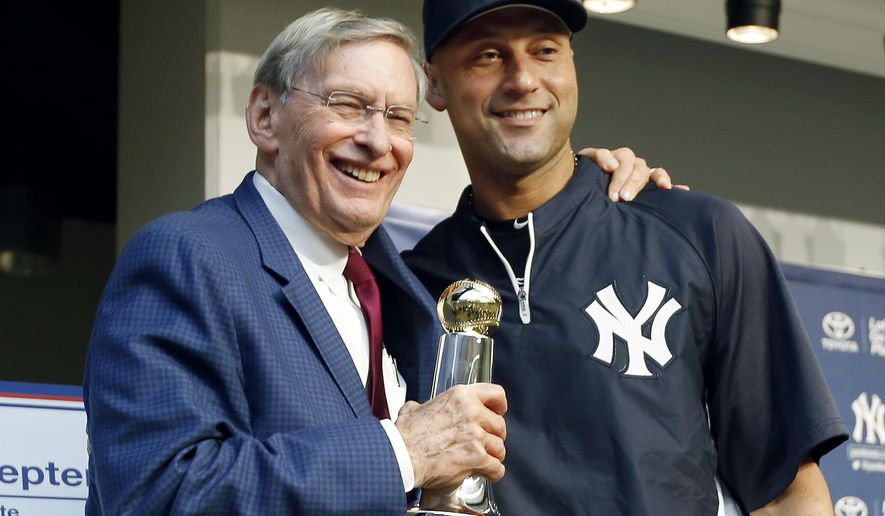 Major League Baseball Commissioner Bud Selig poses for a photograph with New York Yankees Derek Jeter after presenting Jeter with the Commissioner's Historic Achievement Award before a baseball game between the New York Yankees and the Baltimore Orioles at Yankee Stadium in New York, Tuesday, Sept. 23, 2014.  (AP Photo/Kathy Willens)