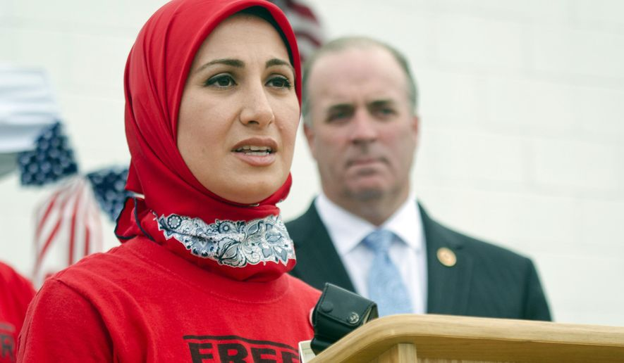 FILE - In this Aug. 29, 2014, file photo, Sarah Hekmati speaks during a Free Amir rally in Bay City, Mich. The family of a former Marine imprisoned in Iran since his arrest three years ago on spying charges said his conditions have improved and he is now allowed to call home several times a week. The sister and brother-in-law of Amir Hekmati acknowledge that's a big step forward for a man who spent his first 16 months held in solitary confinement in Iran's notorious Evin prison, north of the capital, Tehran. But Hekmati's relatives are unwavering in their goal to obtain his release. (AP Photo/The Bay City Times, Danielle McGrew, File)