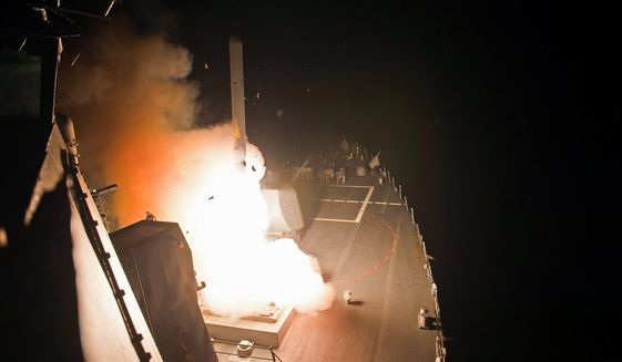 ready, aim, fire: Hours before an American-led military coalition pounded Islamic State strongholds in Syria, the Obama administration informed President Bashar Assad of its plans. (U.S. Navy via Associated Press)
