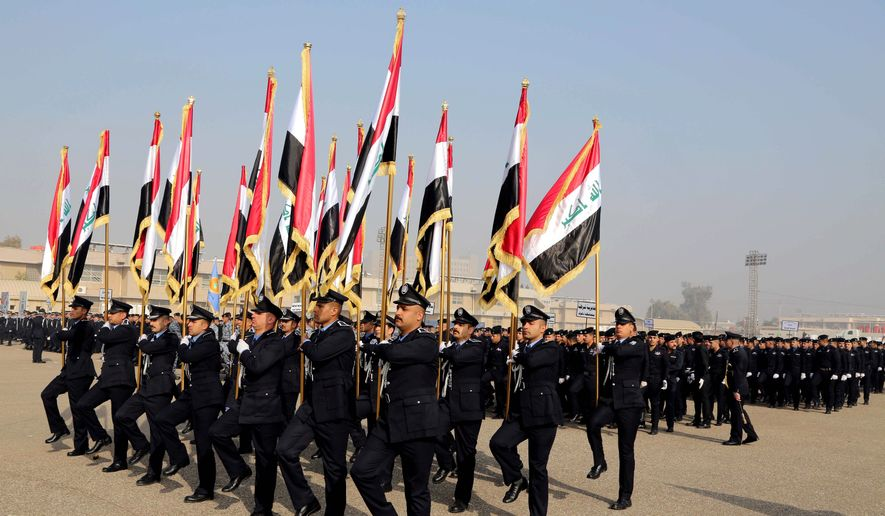 Iraqis mark Police Day in Baghdad. The State Department's decision to close an investigation left unresolved accusations of whether DynCorp let a subcontractor solicit kickbacks from linguists at Baghdad's police academy as a condition of continued employment. The company was hired under a nearly $1 billion task order to provide linguists to work in three Iraqi cities. (Associated Press)