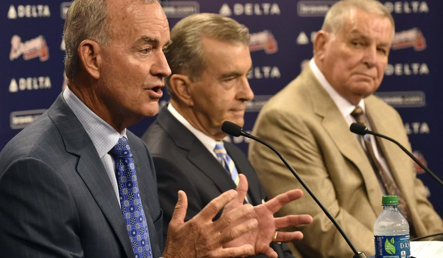 Atlanta Braves interim general manager John Hart, left, answers questions with team president John Schuerholz and former manager Bobby Cox, right, after the baseball team fired general manager Frank Wren following a mid-summer collapse that caused the franchise to miss the playoffs, Monday, Sept. 22, 2014, in Atlanta. (AP Photo/David Tulis)